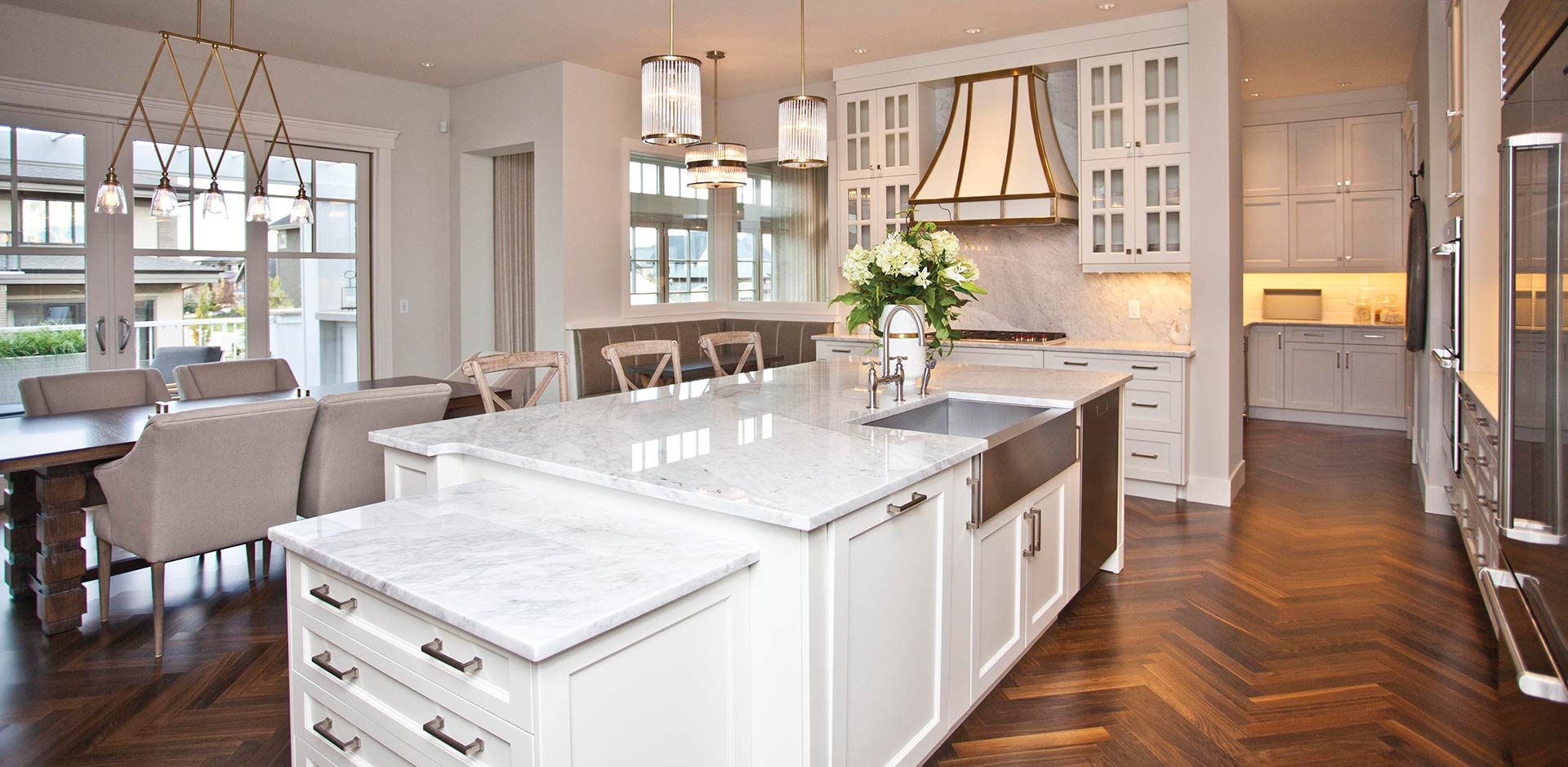 Herringbone Floors and Marble Countertops in a Wolf Custom Kitchen