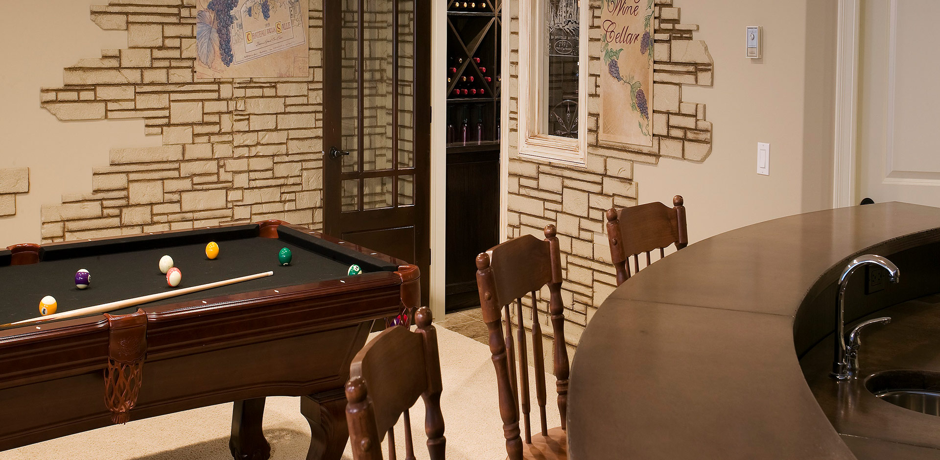 Pool table and Basement Bar in a Wolf Custom Home